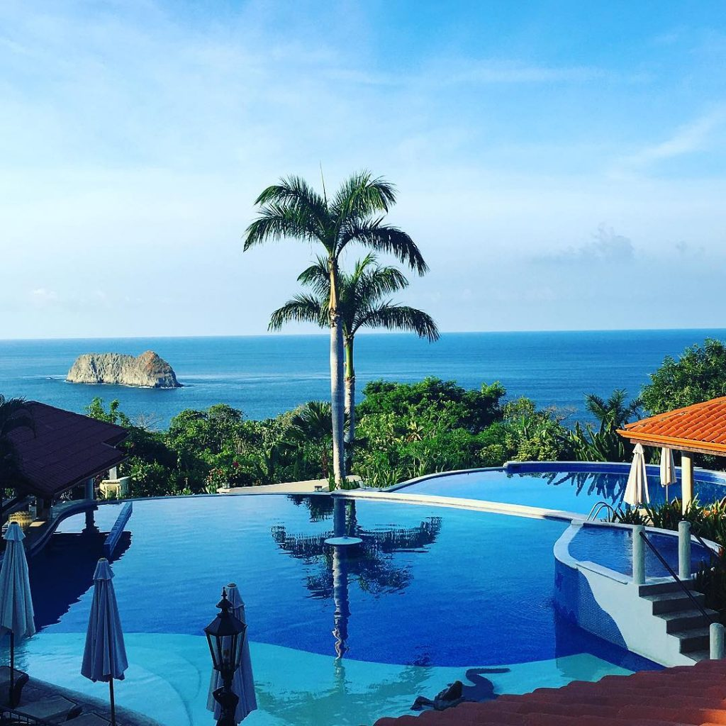 View of the pool and ocean from Hotel El Parador, Manuel Antonio. Photo credit saretmj.